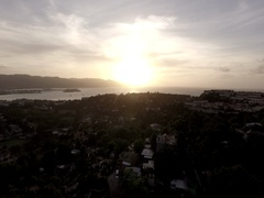 4k Aerial Pushing Into Sunset Over the Hills in Jamaica- RAW Color Stock Footage