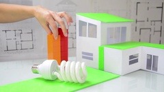 Woman composes cubes  that symbolize the energy  classes. Saving energy concept. Stock Footage