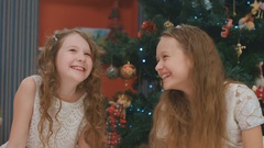 Beautiful girls chating and laughing on Christmas eve, New Year Stock Footage
