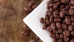 Rotating Raisins (with Chocolate) (seamless loopable; 4K) Stock Footage