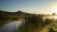 Glastonbury tor and misty dawn on the Somerset Levels in England Stock Footage