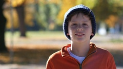 Portrait of Boy with beanie hat in autumn Stock Footage
