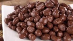 Fresh made Chocolate Raisins (not loopable; 4K) Stock Footage