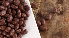 Chocolate Raisins rotating on a wooden plate (not loopable; 4K) Stock Footage