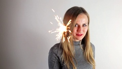 Woman with sparkler Stock Footage