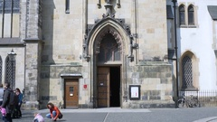 People walk out of church, St. Thomas Church, Leipzig, Germany Stock Footage