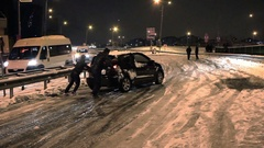 Car struggles and slides uphill in snow icy roads.  Stock Footage