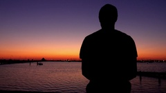 Melbourne, St Kilda Beach: Boy Silhouette Looks At Ocean, Sunset Stock Footage