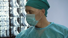 Anesthesiologist taking syringe, injecting medicine to patient before surgery Stock Footage