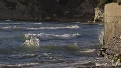Coastal sea wall construction battered by waves, creates rip Stock Footage
