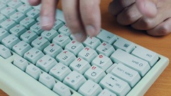 A man is tuping on the keyboard numbers Stock Footage