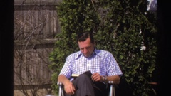 1969: man reading a book MICHIGAN Stock Footage