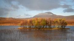 Rainbow over Scottish landscape. Stock Footage