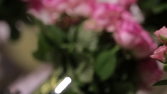 A large bouquet of bright pink roses with green buds and leaves, close-up Stock Footage
