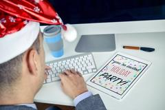 Text christmas party you are invited in a tablet Stock Photos