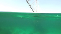Underwater old sailing fishing boat at anchor. Stock Footage