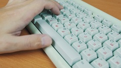 A man playing a computer game, the keyboard controls Stock Footage