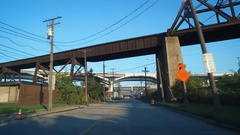 CLEVELAND - INDUSTRIAL AREA - DRIVING INTO CITY UNDERNEATH BRIDGES Stock Footage