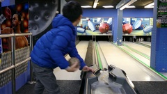 Boy throws bowling ball to beat skittles Stock Footage