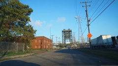 CLEVELAND - DRIVING SHOT - APPROACHING CLEVELAND THROUGH INDUSTRIAL VALLEY Stock Footage