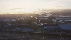 Yellow tone cinematic style video of industrial region in big city. Smokestack Stock Footage