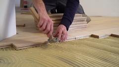 Worker installing wood parquet. Stock Footage