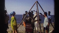 1969: group of people overseeing a large fish being hung from a wooden structure Stock Footage
