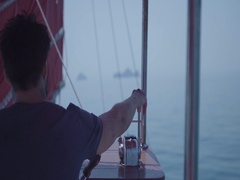 Captain on deck of large ship steering a wheel. Sailor at the helm of a sailboat Stock Footage