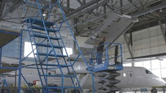 Aircraft Repair Plant. Man repairing aircraft. Stock Footage