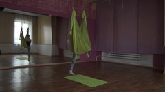 One type of yoga - aerial yoga. A young girl engaged in aerial yoga. This type Stock Footage