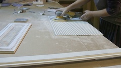 Female carpenter polishing and grinding board on the furniture factory Stock Footage