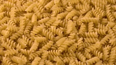 Uncooked italian pasta rotating background Stock Footage