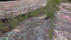 Road cracked in abandoned city of Centralia Pennsylvania 4k Stock Footage