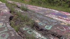 Road with cracks in foundation from coal mine fire tilt 4k Stock Footage