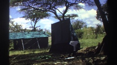 1969: a group of men attempt to assemble a tent together NIGERIA Stock Footage