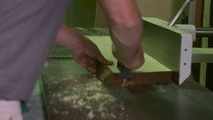 A worker planing the board on the furniture factory Stock Footage