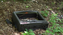 Old television in woods with broken screen 4k Stock Footage