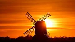 Timelapse of an English Windmill at sunset Stock Footage