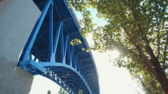 CLEVELAND, CLOSE UP OF BLUE BRIDGE (TRUSS) WITH SUN GLINT Stock Footage