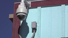 Security camera on exterior of store building 4k Stock Footage