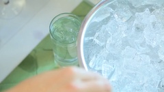 Bartender throws ice in a glass Stock Footage