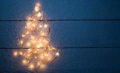 Christmas card with luminous garland Stock Photos