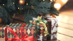 Cristmas gift box near xmas tree Stock Footage