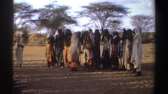 1969: two ladies dancing according the to the song of women beside them SUDAN Stock Footage