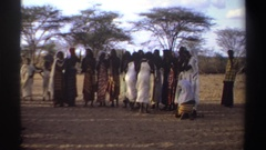 1969: people in row wearing wrapped garments and head scarves clap with two Stock Footage