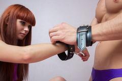Sexy couple handcuffed. sex Toys Stock Photos