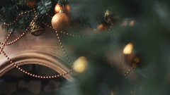 Cristmas tree with lights on fireplace background Stock Footage