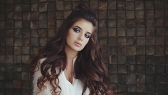 Portrait of attractive wistful brunette woman with bright smokey eyes make-up Stock Footage
