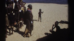 1969: african children learning the traditions of the tribe passed down from the Stock Footage