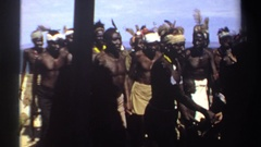 1969: aboriginals of dark skin sing and dance in a sandy area near the sea SUDAN Stock Footage